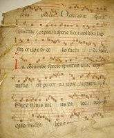 parchment leaf with musical notes and text on it